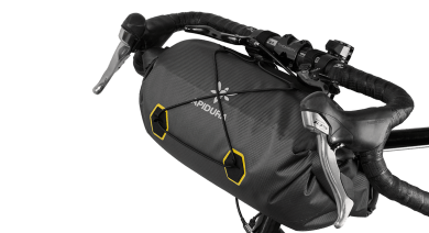 Apidura's bikepacking bag the Expedition Handlebar Pack 14L Perspective On Bike