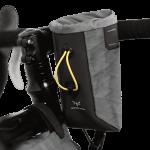 Apidura's bikepacking bag the Backcountry Food Pouch On Handlebar Shot