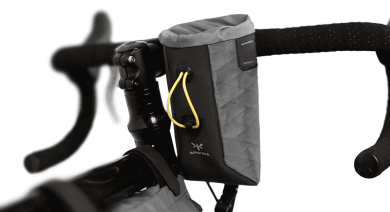 Apidura's bikepacking bag the Backcountry Food Pouch On Handlebar Shot