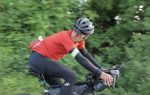 bjorn lenhard on his bike with apidura expedition compact frame pack