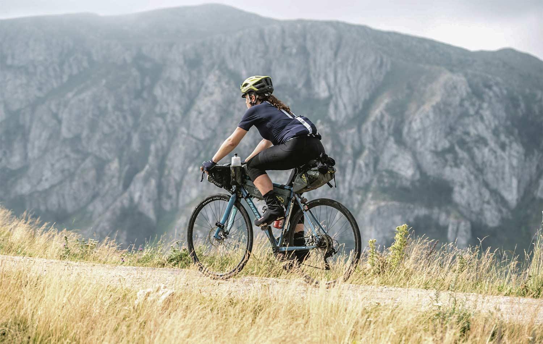 cyclist on bike with apidura bags