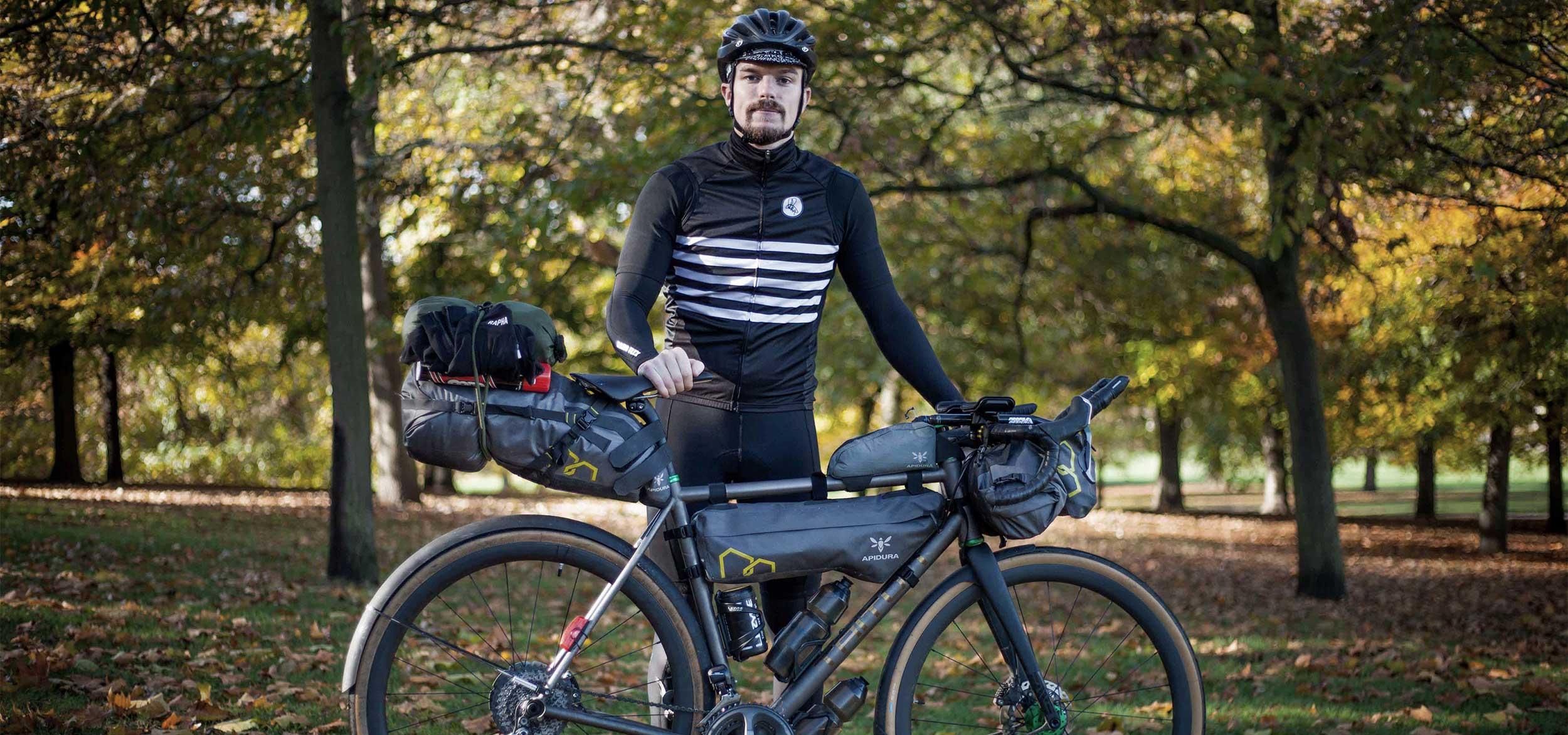 presentation of andrew mathias with his bike apidura packs