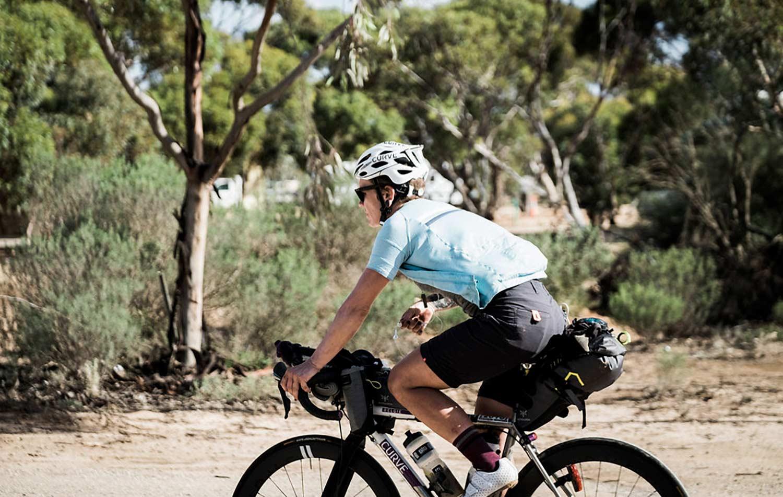 sarah hammond with apidura bikepacking bags solo female cycling