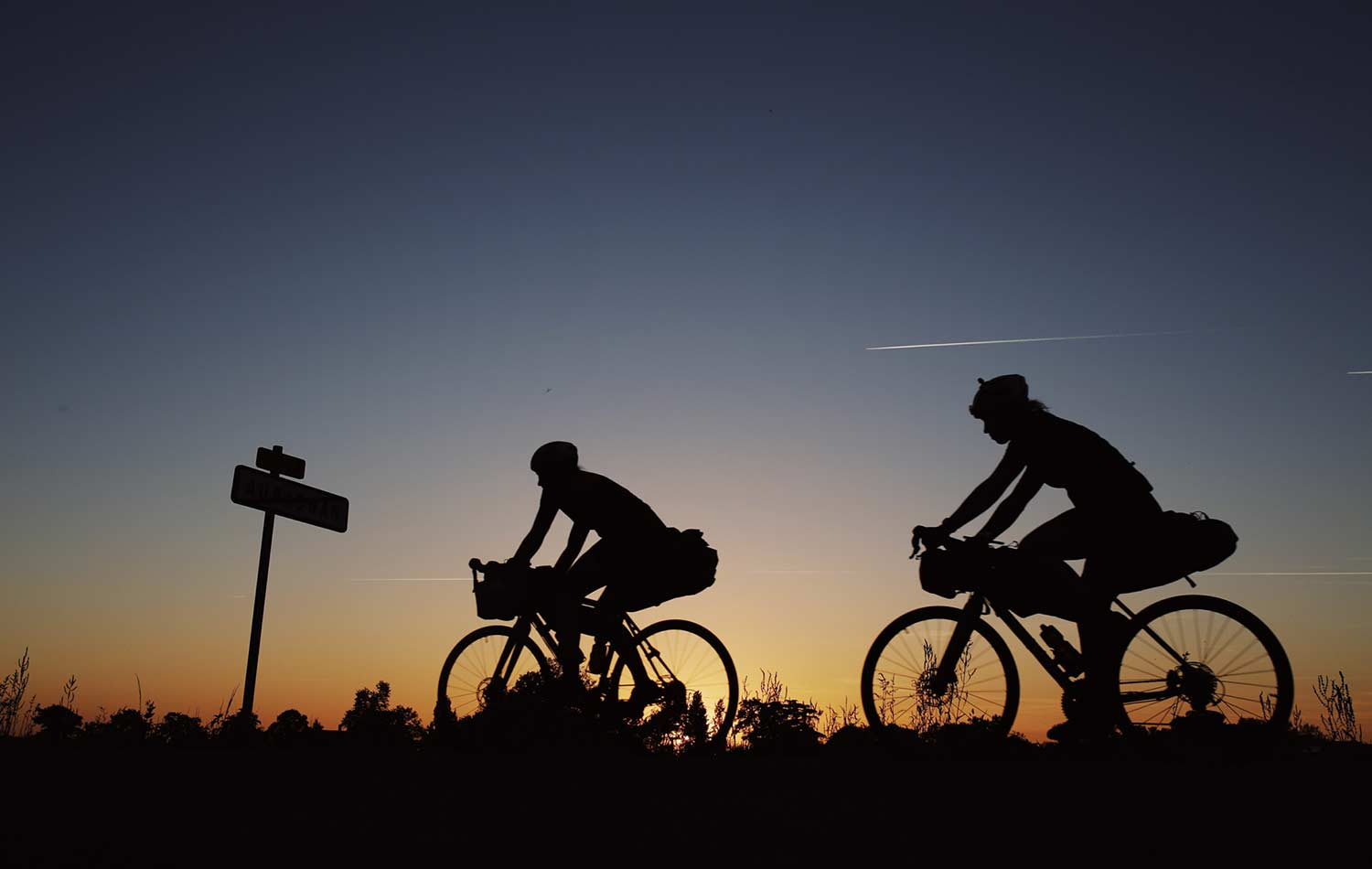 sunset on bike with Adventure Syndicate