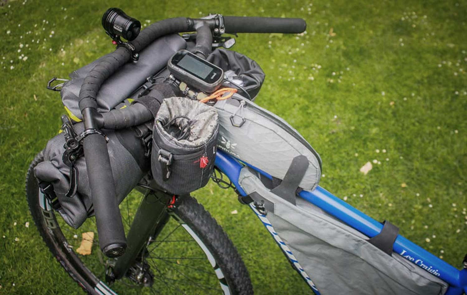 cockpit of lee craigie bike with apidura backcountry top tube packs solo female cycling