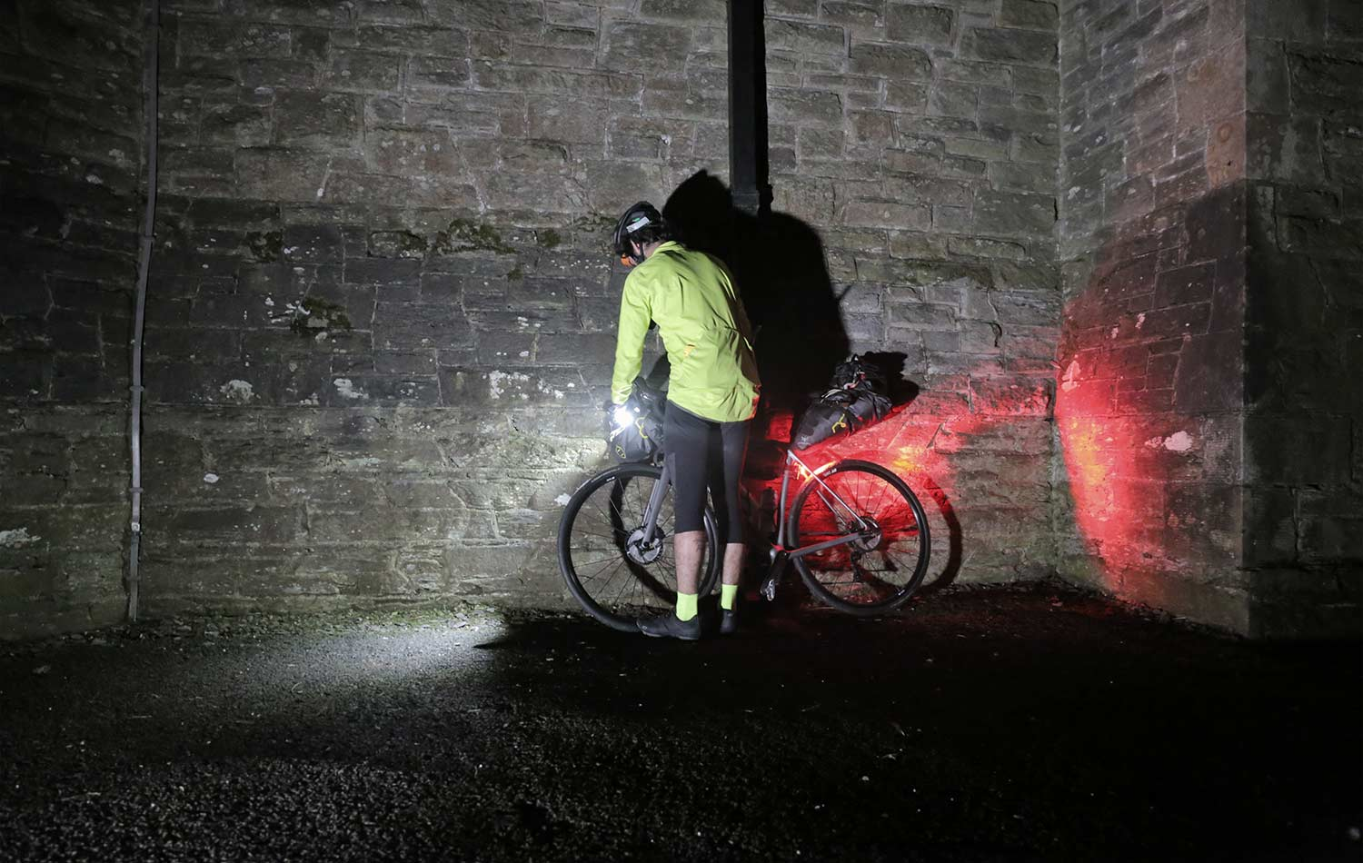 tomy mulledy garcia fixing his bike lights by night before the transatlantic way
