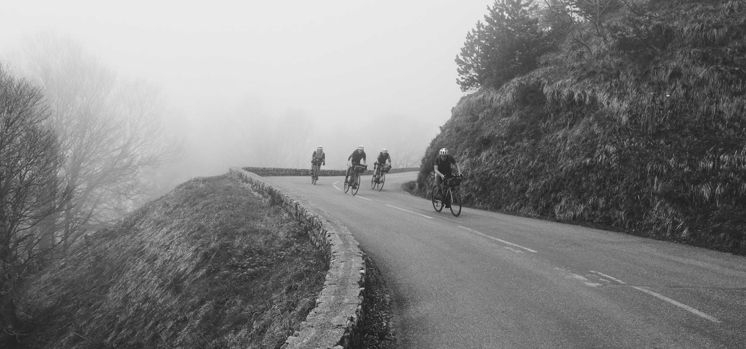 Adventure Syndicate Riding Downhill in France. Bikepacking Apidura