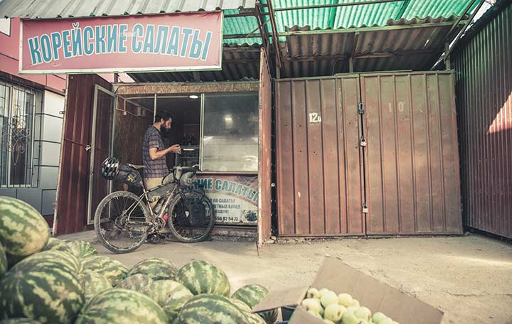 Apidura Ambassador's Marc Maurer buying food in Kyrgyzstan - A bikepacking Story