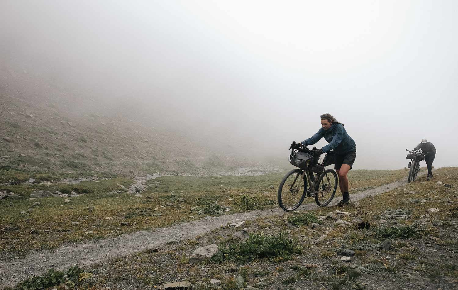 Jenny Tough and her friend cycling on the Silk Road Mountain Race | Apidura