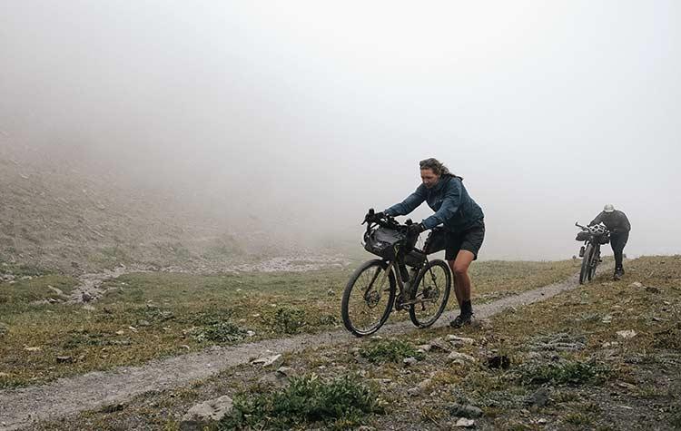 Jenny Tough off road cycling in Kyrgyzstan. Bikepacking | Apidura