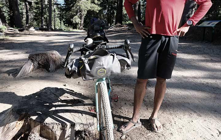 Naresh Kumar showing his bikepacking bags | Apidura
