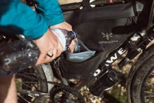A rider fills an Innovation Lab Hydration Bladder inside their Expedition Full Frame Pack