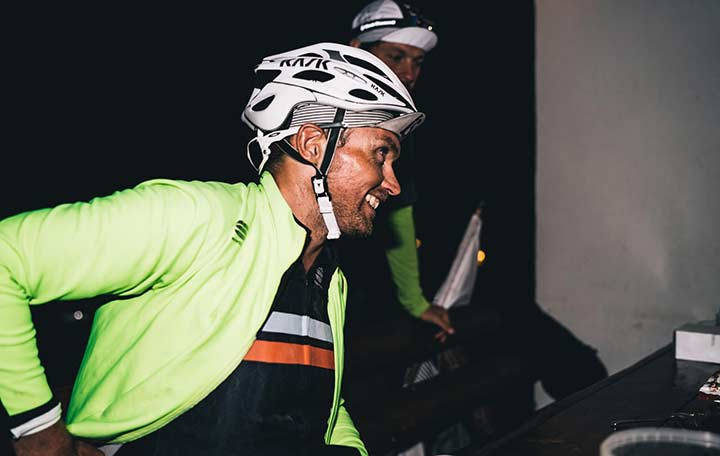 A men smiling wering a helmet