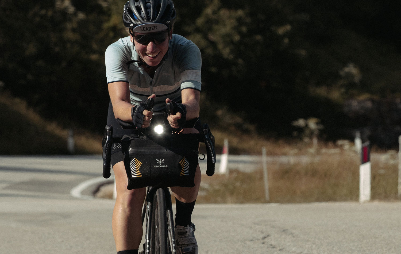 Fiona Kolbinger riding her bike on the TCR with het full bikepacking winning kit