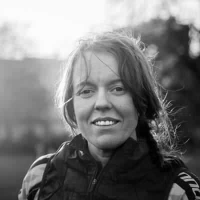 Jenny Graham smiling in black and white