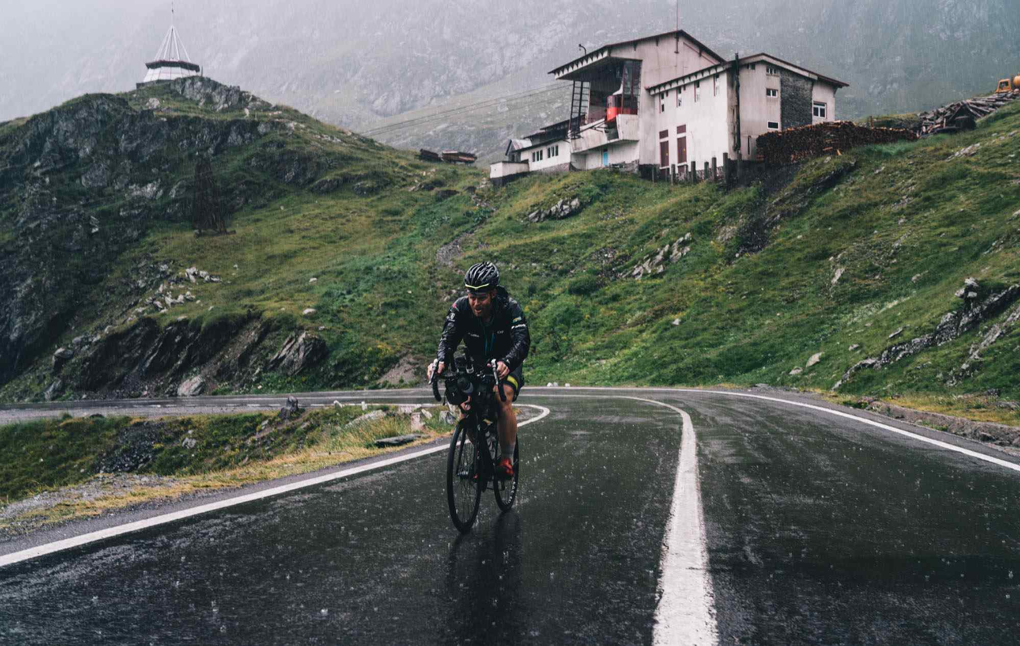 A man cycling in the rain