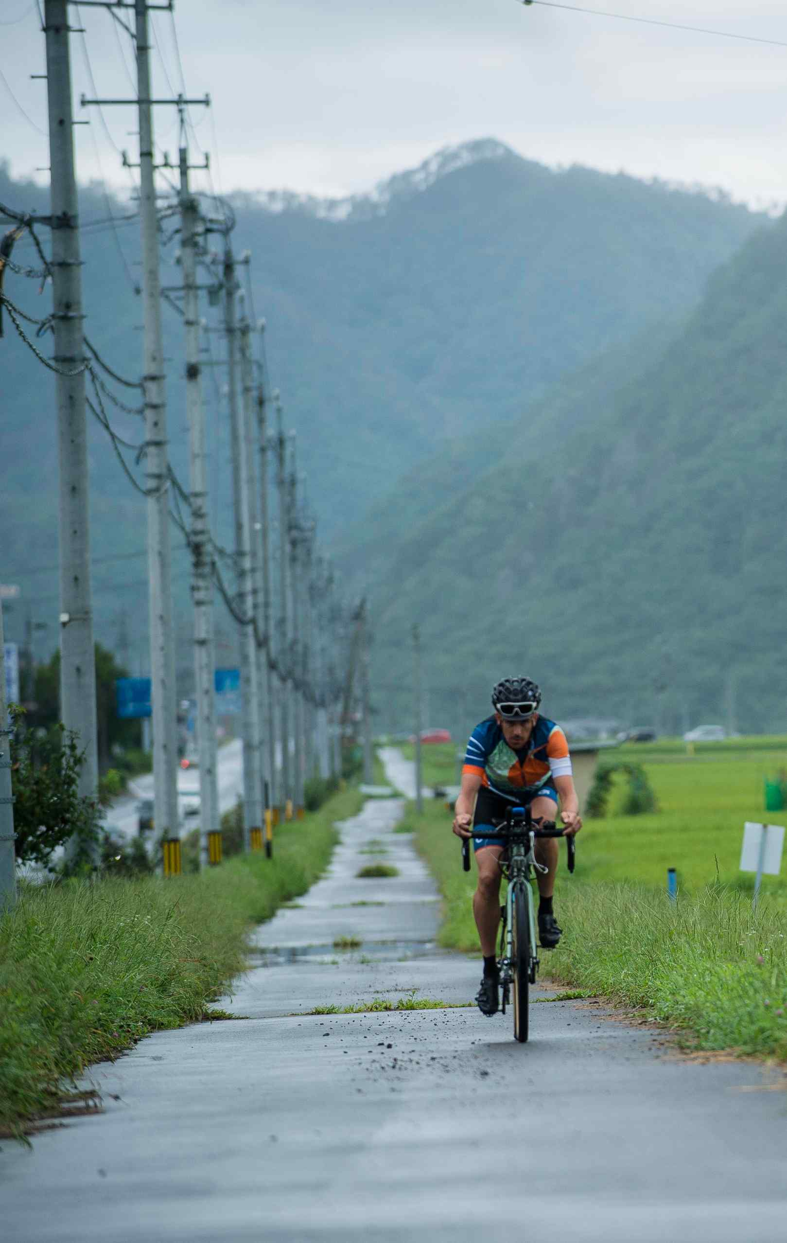 A cyclist riding in the Japanese Odyssey