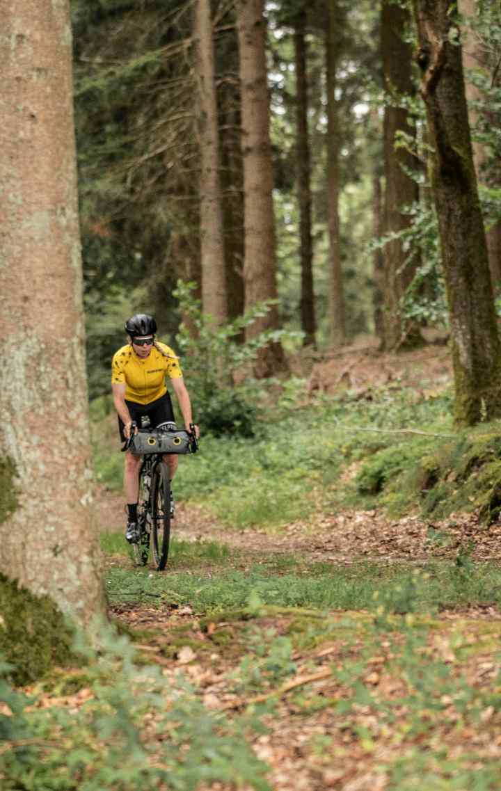 A cyclist in the forest