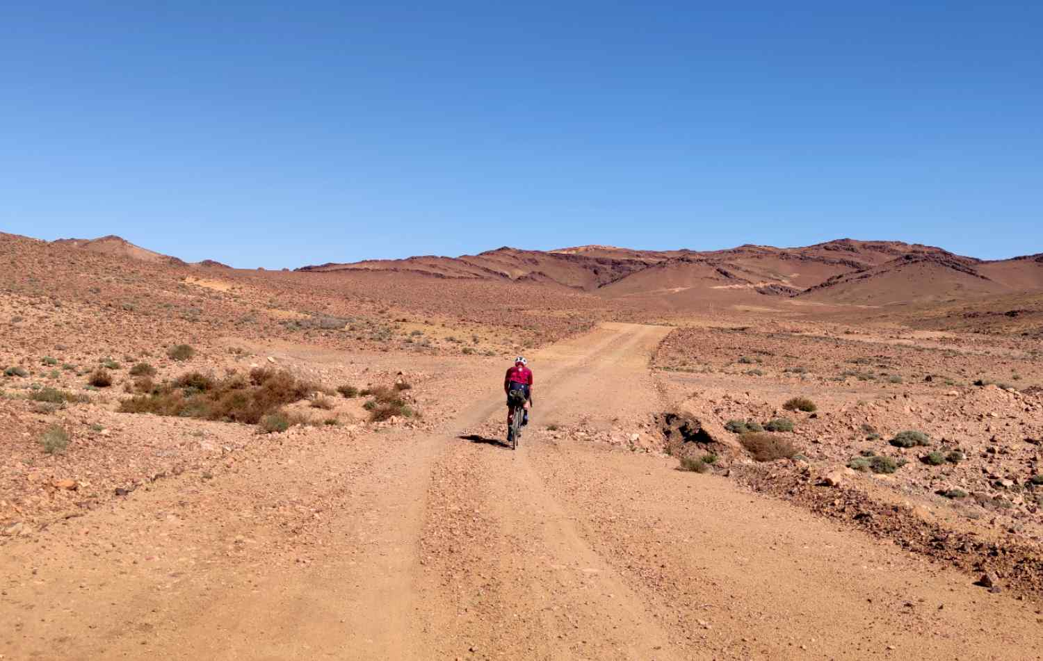 A cyclist in the middle of the desert