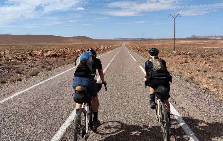 Two people bikepacking in the desert