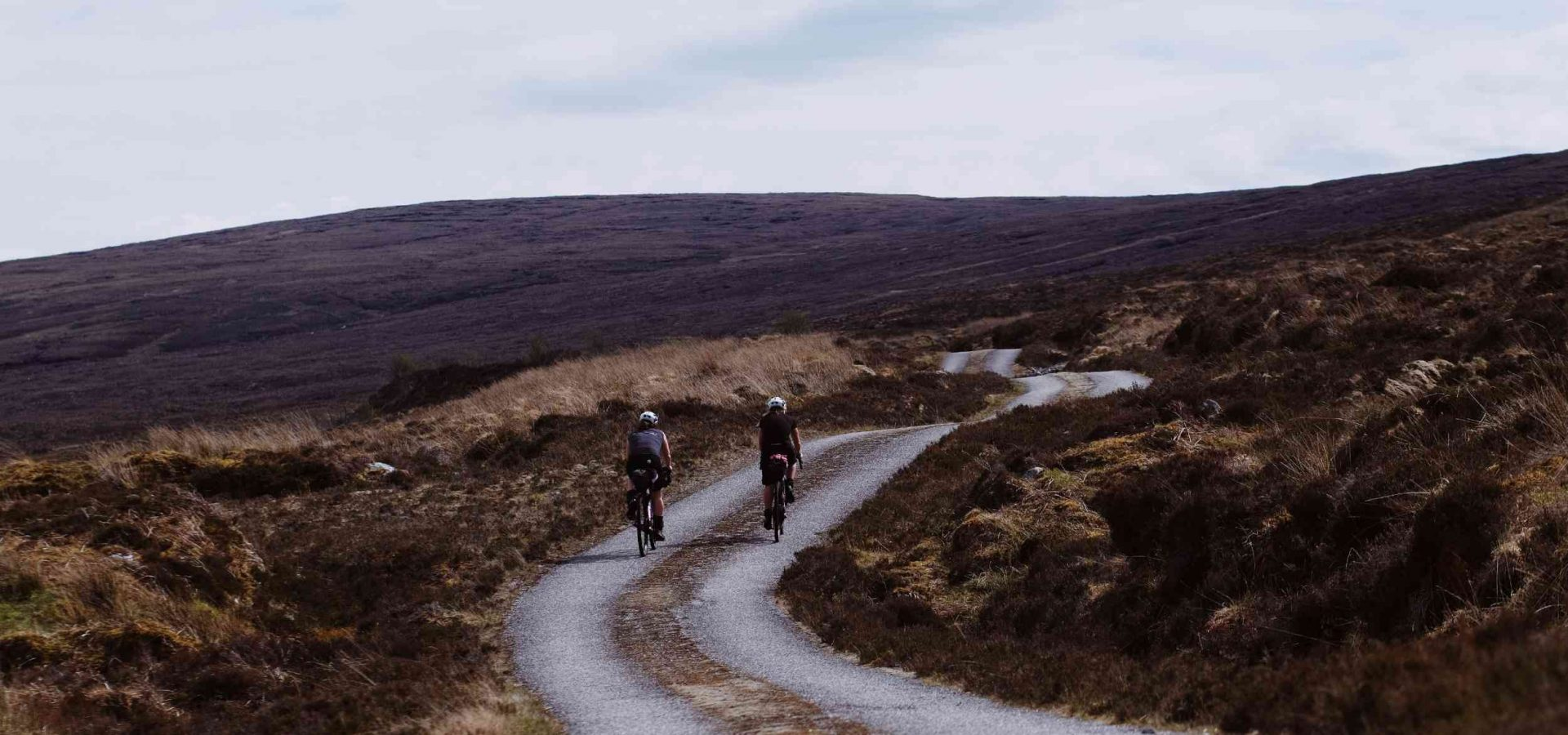 two cyclist bikepacking in the middle of a mountain