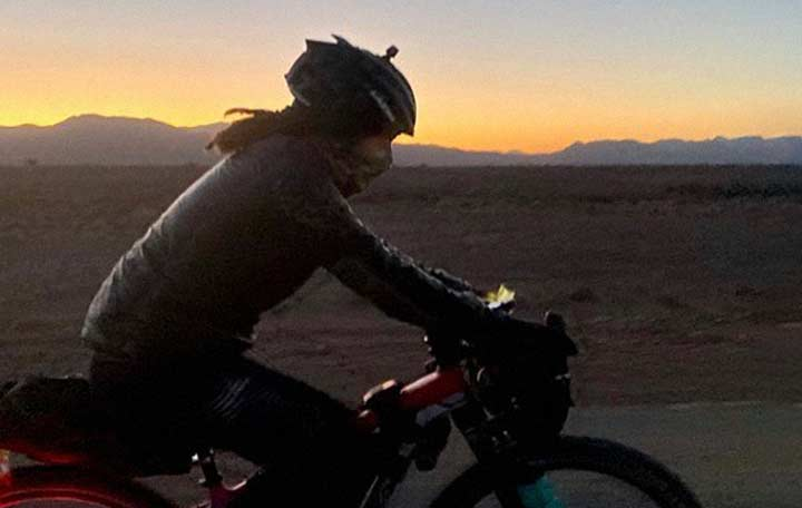A woman cycling in the mountain