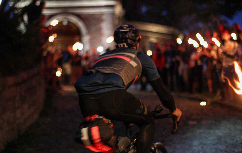 Geraardsbergen Muur, cycling in a city during the night