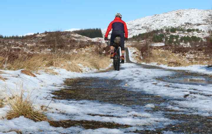 Markus cycling in a snowy dirt road