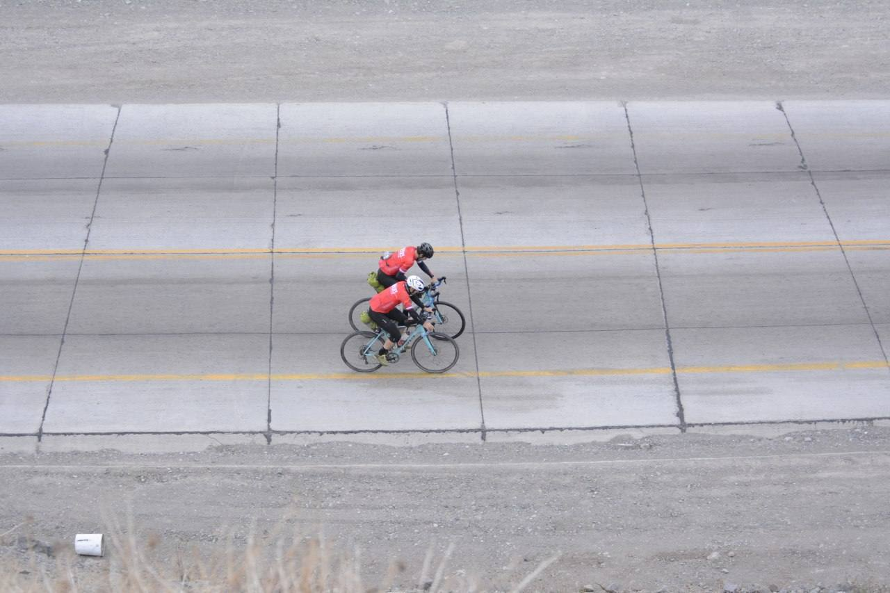 Two people racing on a bike