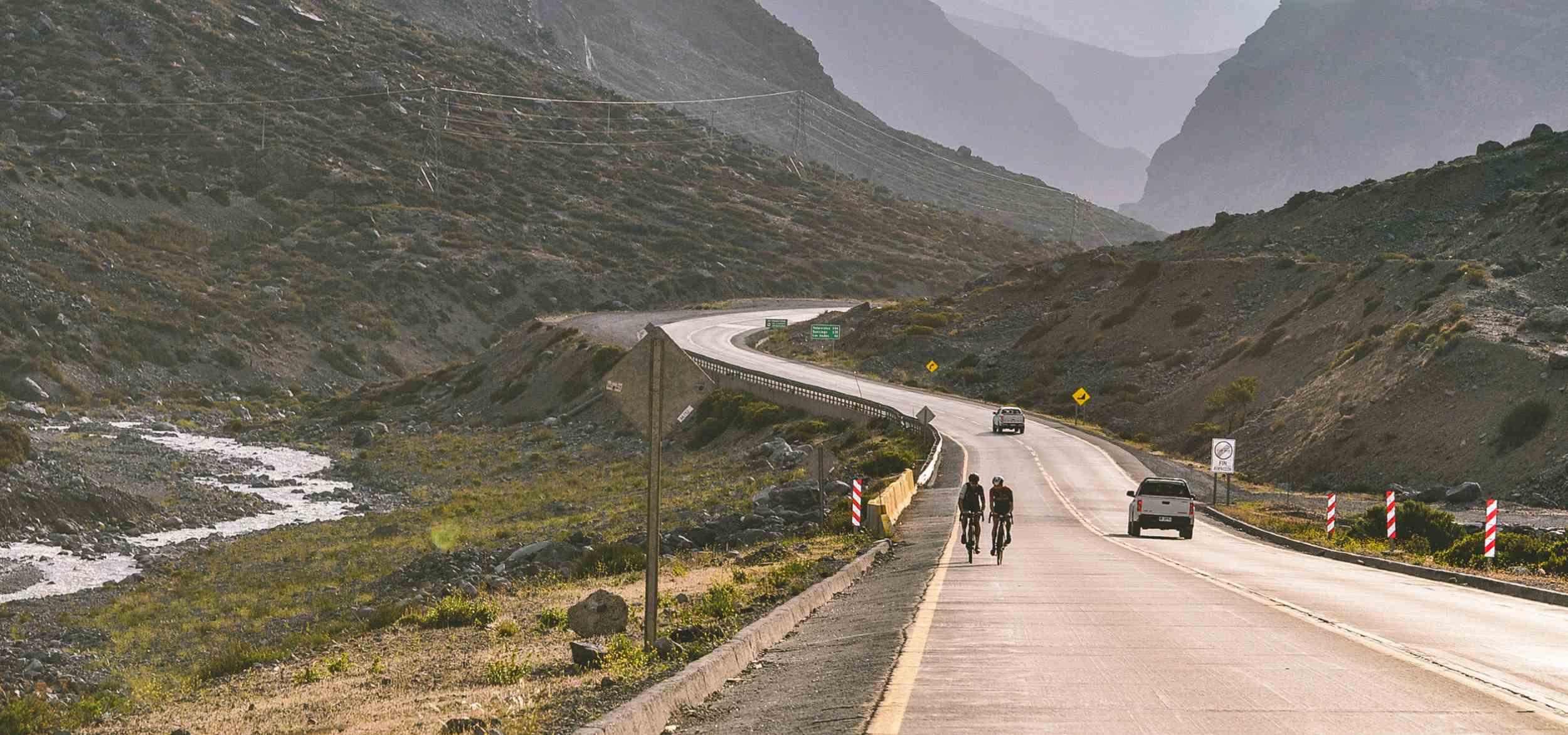 Two people riding down the mountain on their bikes