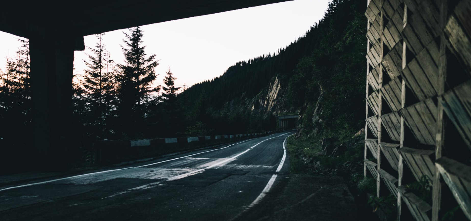 cycling through sunset under mountain road underpass