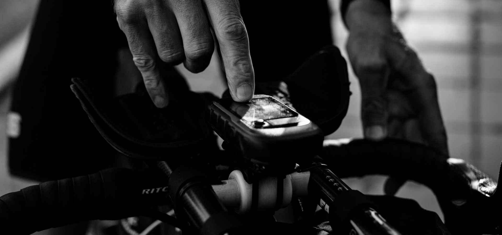hand using garmin device for bikepacking route planning