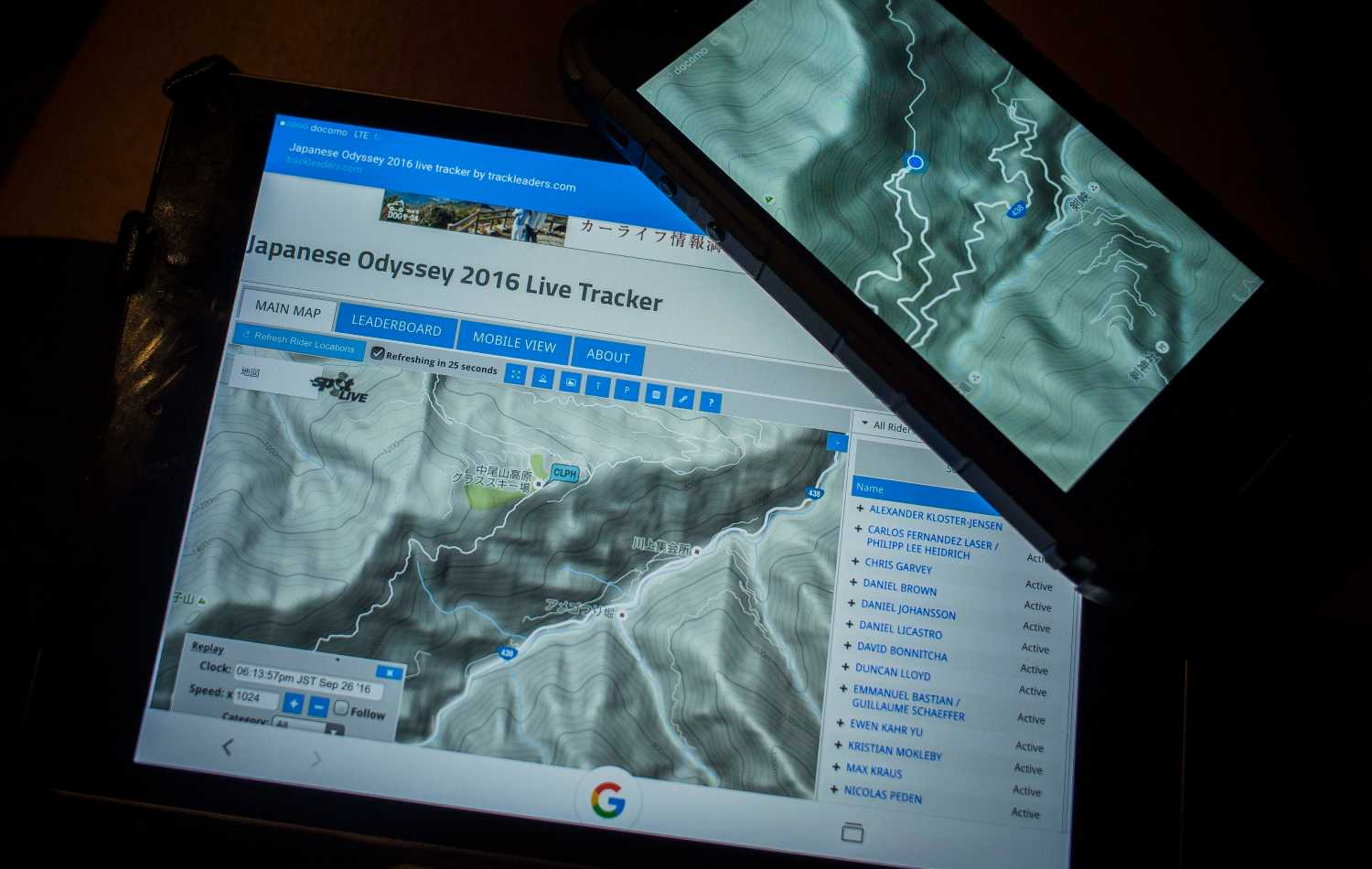 A tablet and a mobile phone show tracking data for the race