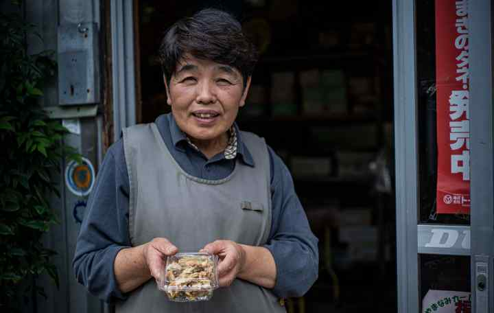 A local store clerk offers food