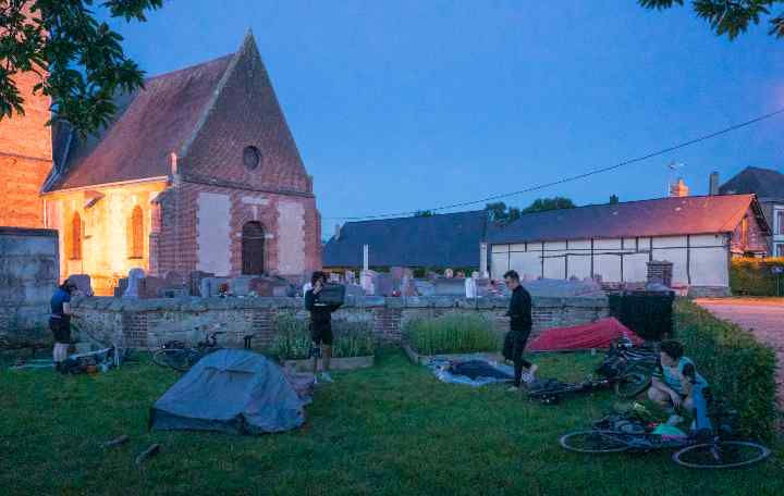 Cyclists set up camp in the grounds of a church