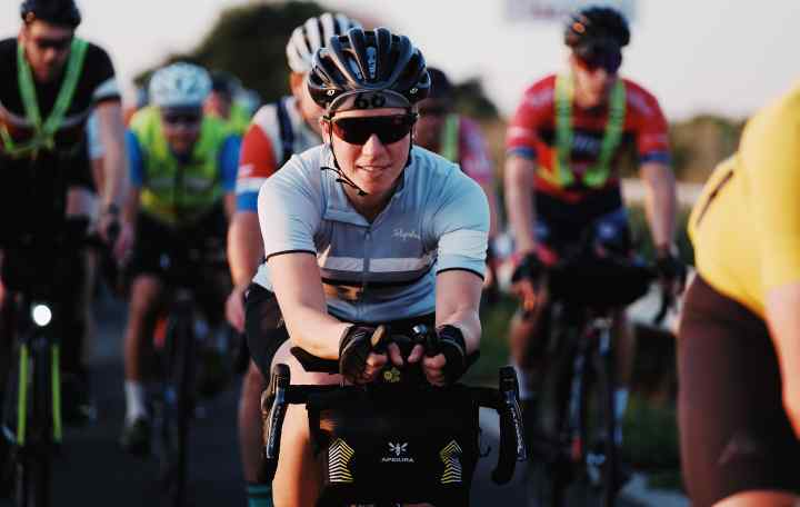 Fiona rides at the front of the TCR, with Apidura Racing Series packs on her bike