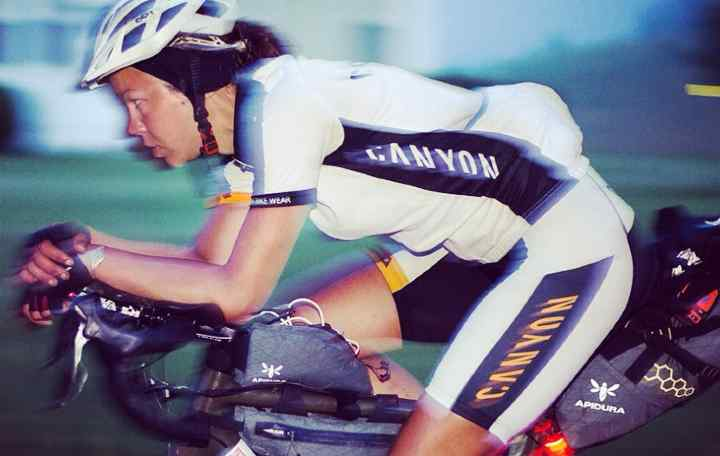 Juliana Buhring racing in the Trans America Bike Race on her road bike covered in Backcountry bags