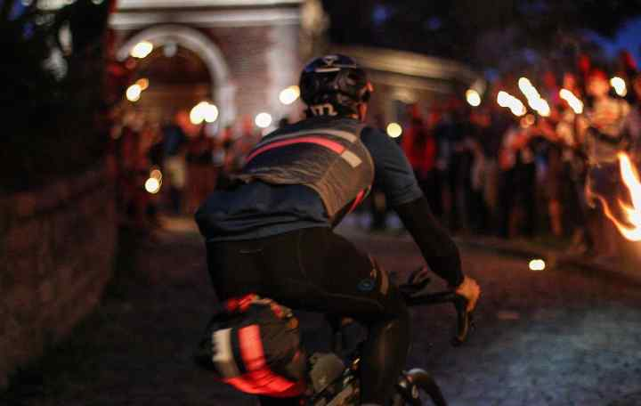 a cyclist riding in a city
