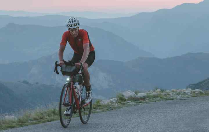 Kristof Allegaert riding in the mountains at the TCR with Apidura packs on his bike