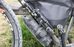 An Apidura Expedition Downtube Pack on a bike, providing extra water carrying capacity