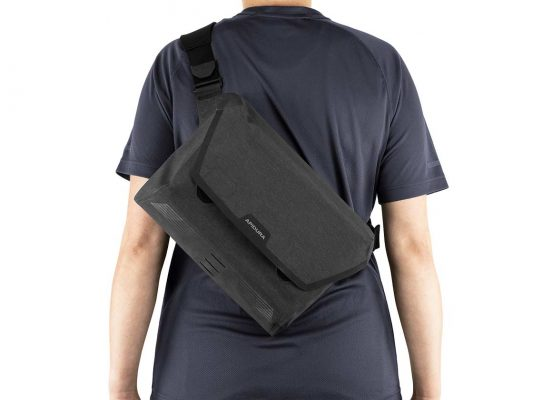 Close-up of the back of a person with a waterproof messenger bag on it