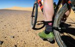 A rider's foot on the pedal of their bike