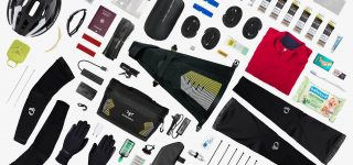 bikepacking kit list: racing handlebar bag and saddle bag with their accessories and elements around