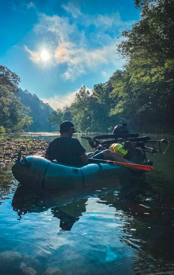 Ernie floats on the river in his loaded packraft