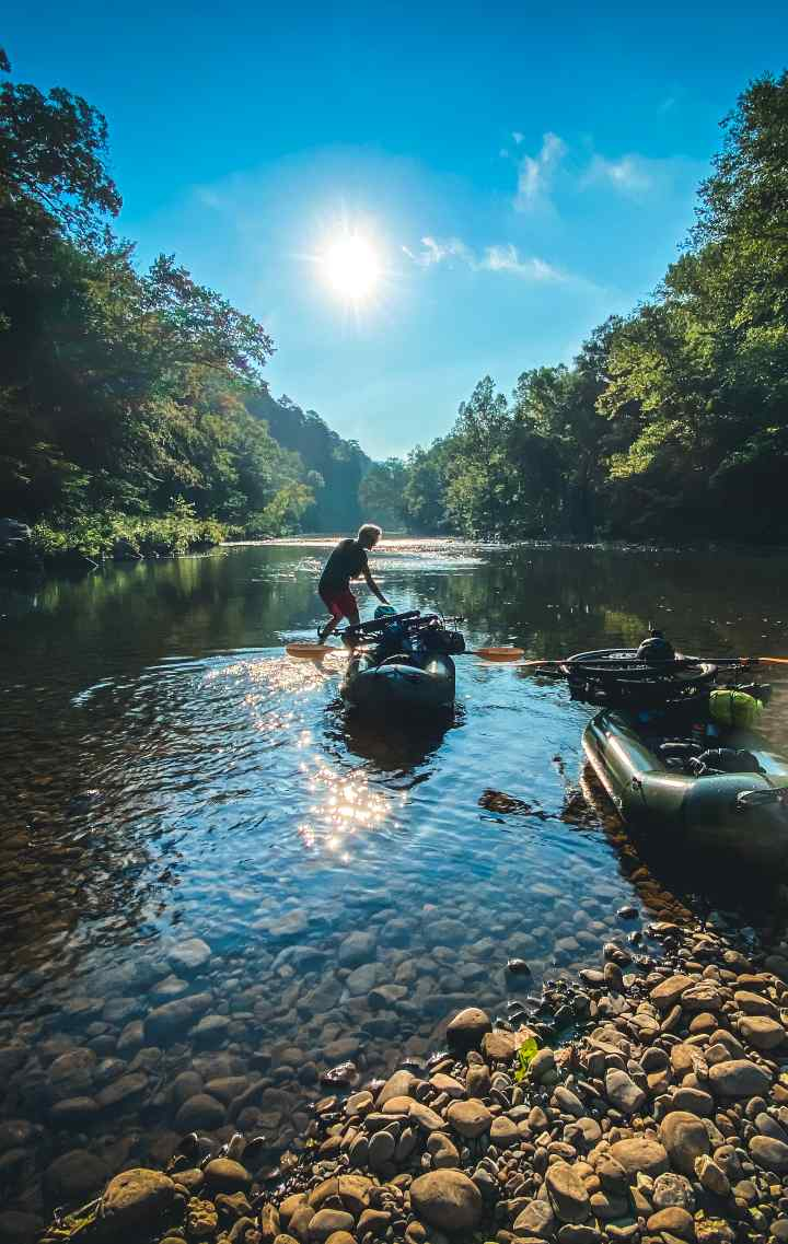 Scotti drags her loaded packraft into the river