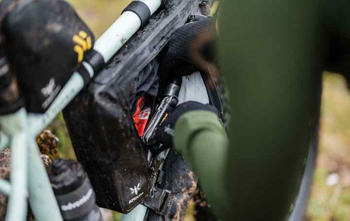 A close up view of Jenny Tough packing her frame pack
