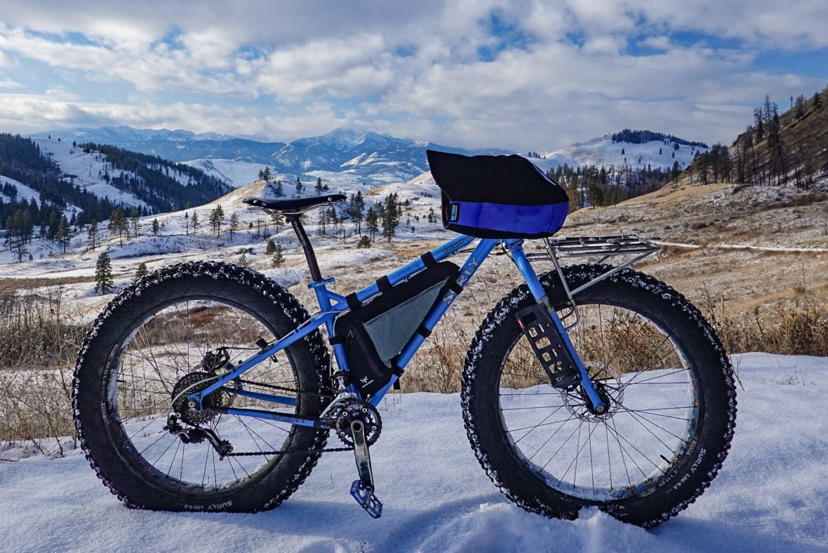 A Surly Fatbike with a Backcountry Full Frame Pack being testing in the Canadian Rockies in freezing conditions