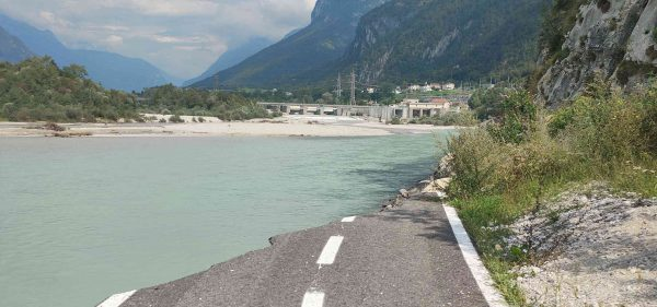 A cycle path washed away by a river