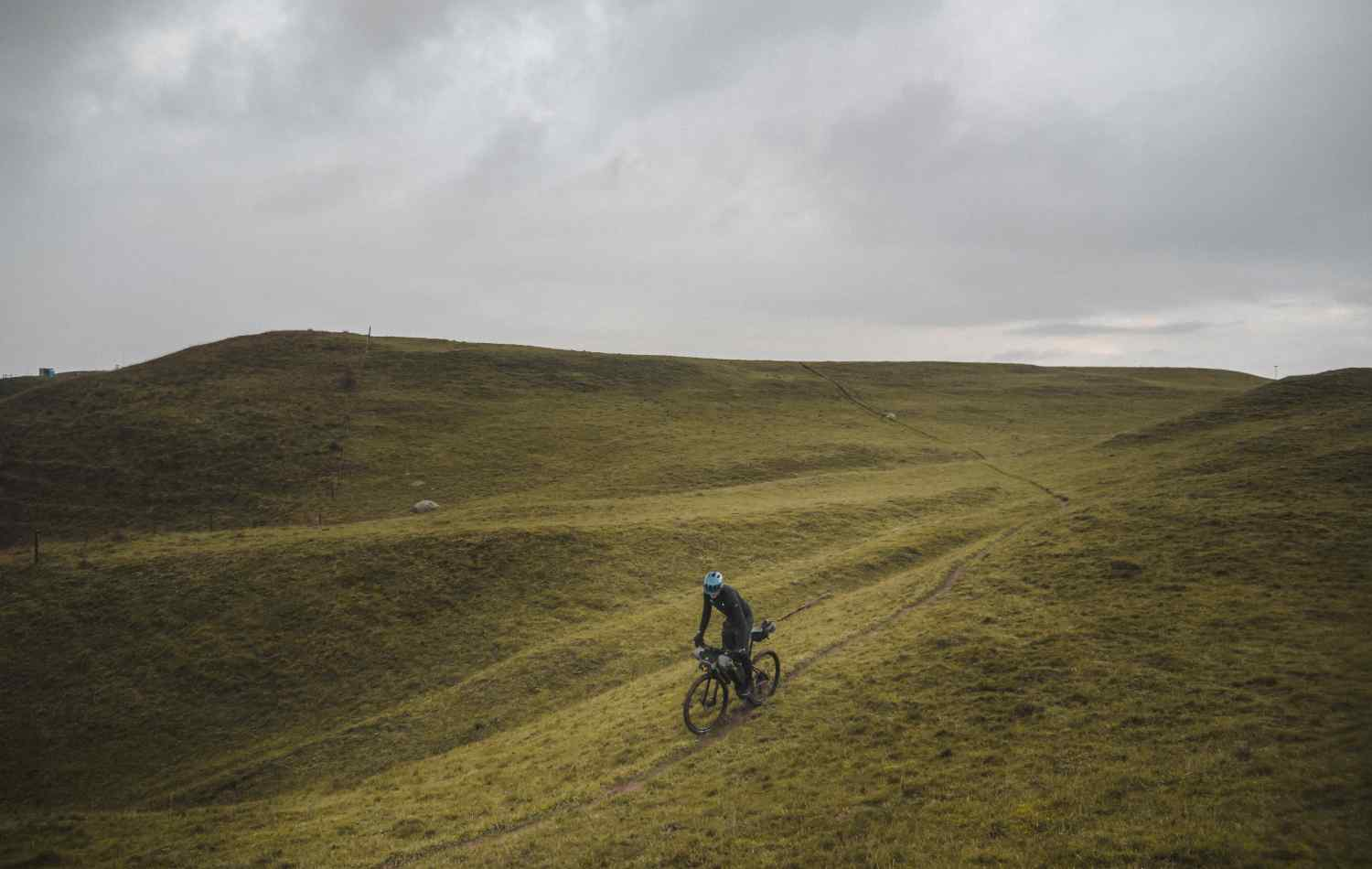 A cyclist rides through the remote backcountry