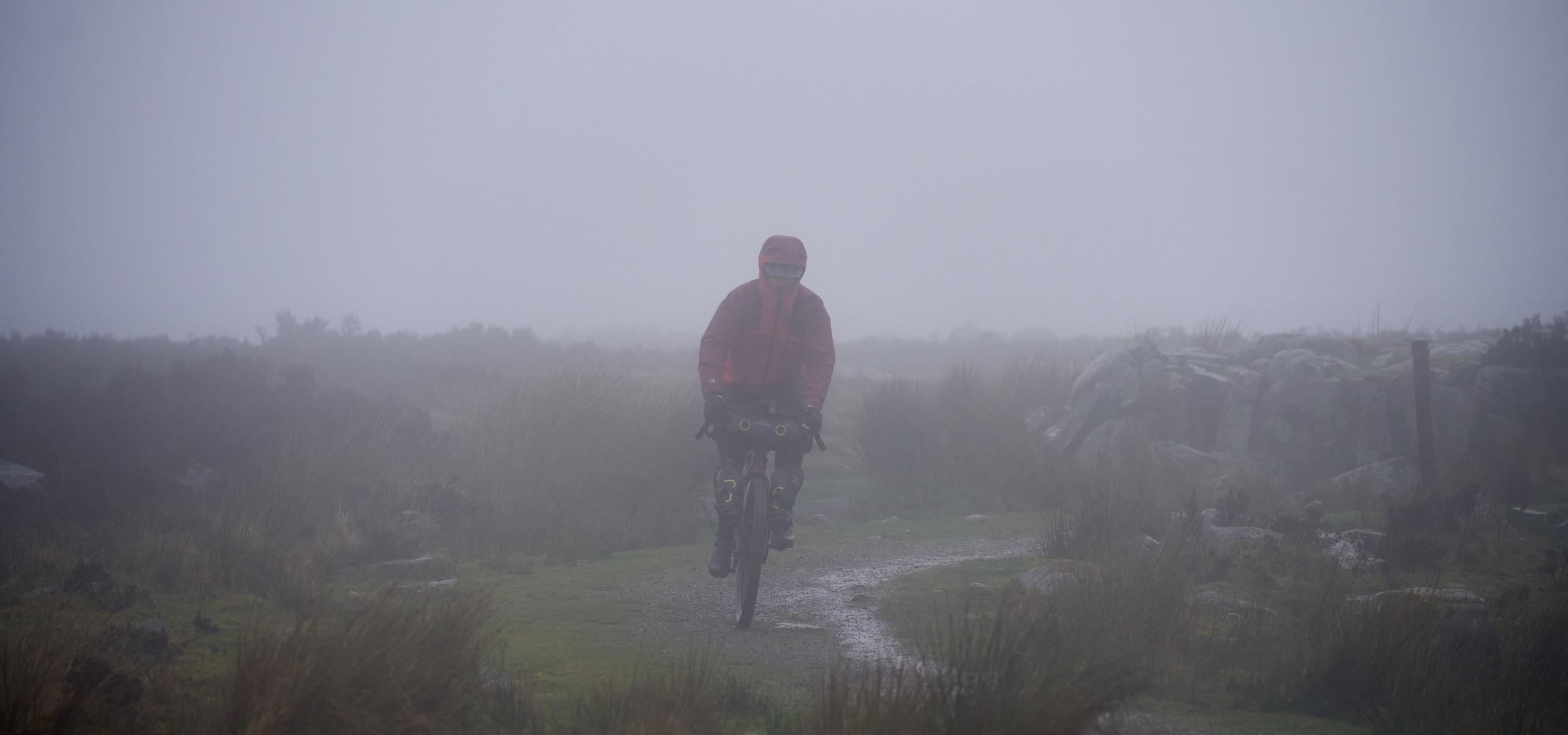 A rider in heavy mist